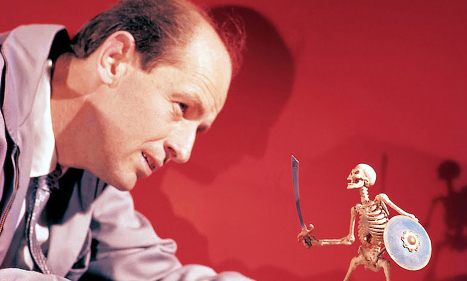 Ray Harryhausen positions a figure on set