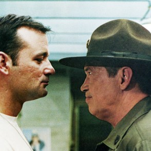 Bill Murray and Warren Oates talk closely in Stripes