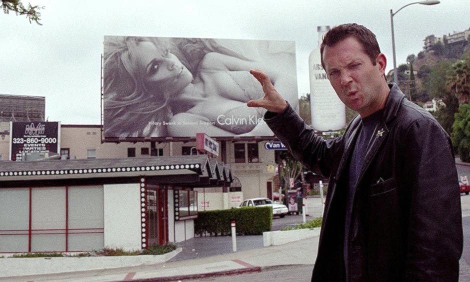 Thomas Lennon, star of The State and Reno 911, fools around with Hilary Swank on Sunset Boulevard while posing for Twenty Seven and a Half Photography.